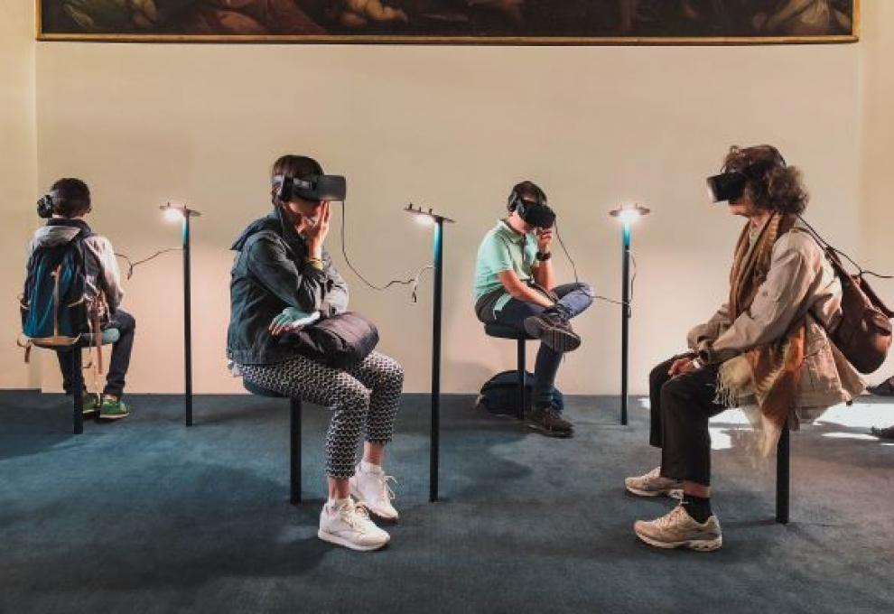 A group of people wearing VR headsets