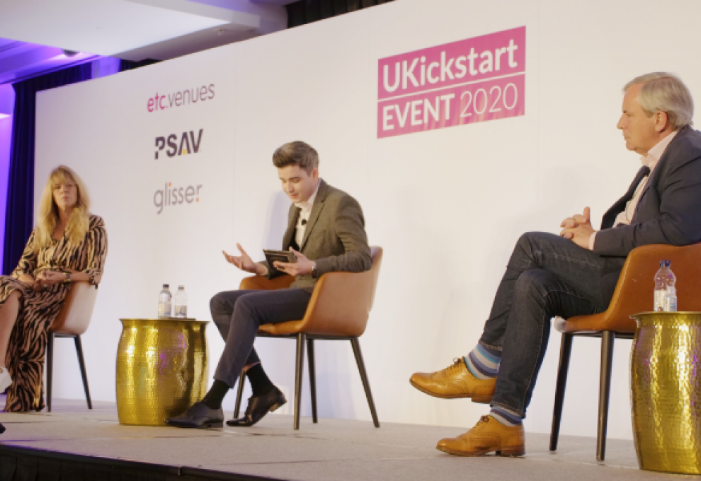 UKickstart main panel, two men and a woman sat on a stage