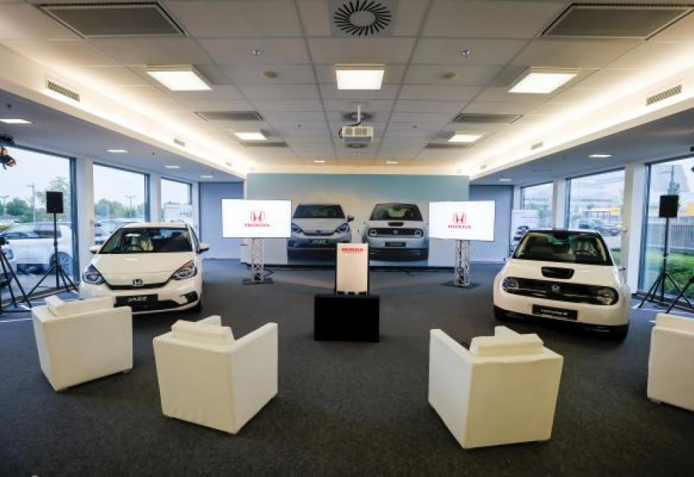 The Honda Academy, Frankfurt. Two white cars in a brighly lit room with four white chairs spaced out in front of them.