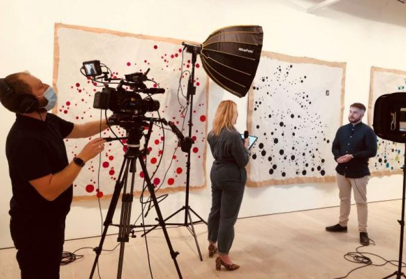 A camera crew filming at the Saatchi gallery